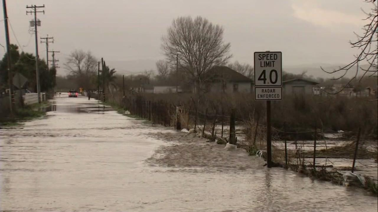 Water floods a roadway in Hollister, Calif. Jan. 11, 2017.