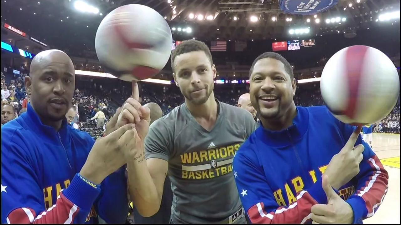 This is an undated image of Golden State Warriors star Stephen Curry with the Harlem Globetrotters in Oakland, Calif.