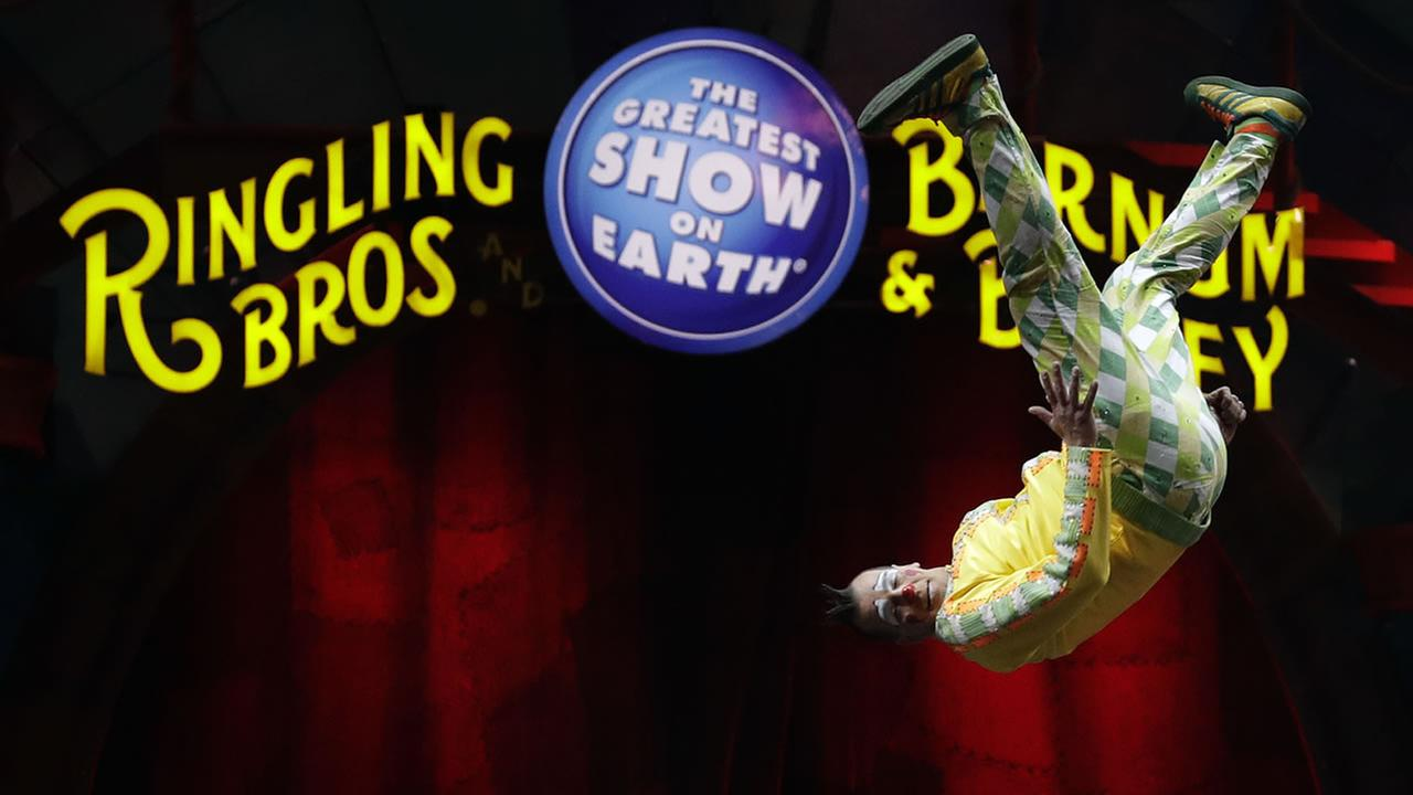 A Ringling Bros. and Barnum and Bailey clown does a somersault during a performance Saturday, Jan. 14, 2017, in Orlando, Fla. (AP Photo/Chris OMeara)