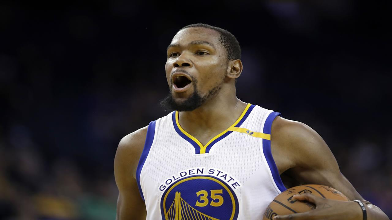 Golden State Warriors Kevin Durant (35) reacts to a foul call during the second half of an NBA basketball game against the Miami Heat Tuesday, Jan. 10, 2017, in Oakland, Calif.