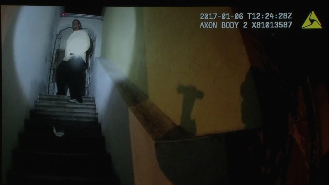 A still from police body camera video shows Sean Moore on top of a staircase in San Francisco on Jan. 6, 2017.