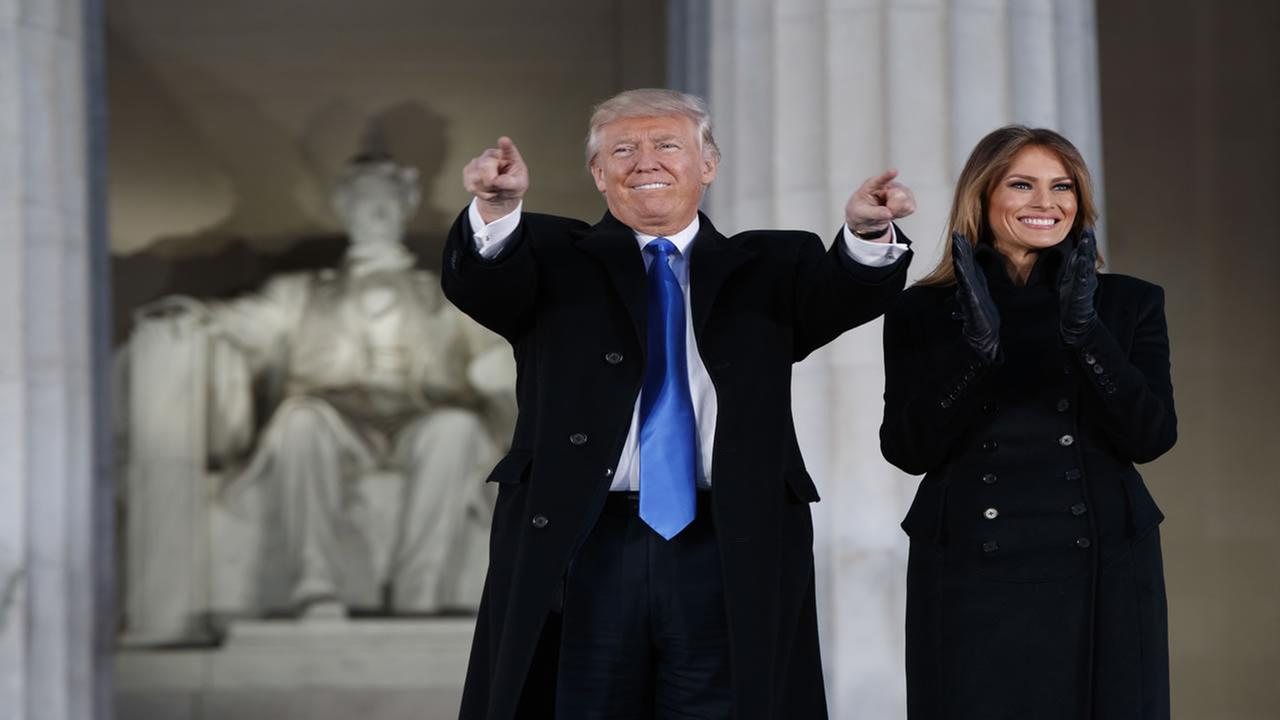 President-elect Donald Trump, left, and his wife Melania Trump arrive to the Make America Great Again Welcome Concert at the Lincoln Memorial on Jan. 19, 2017, in Washington.