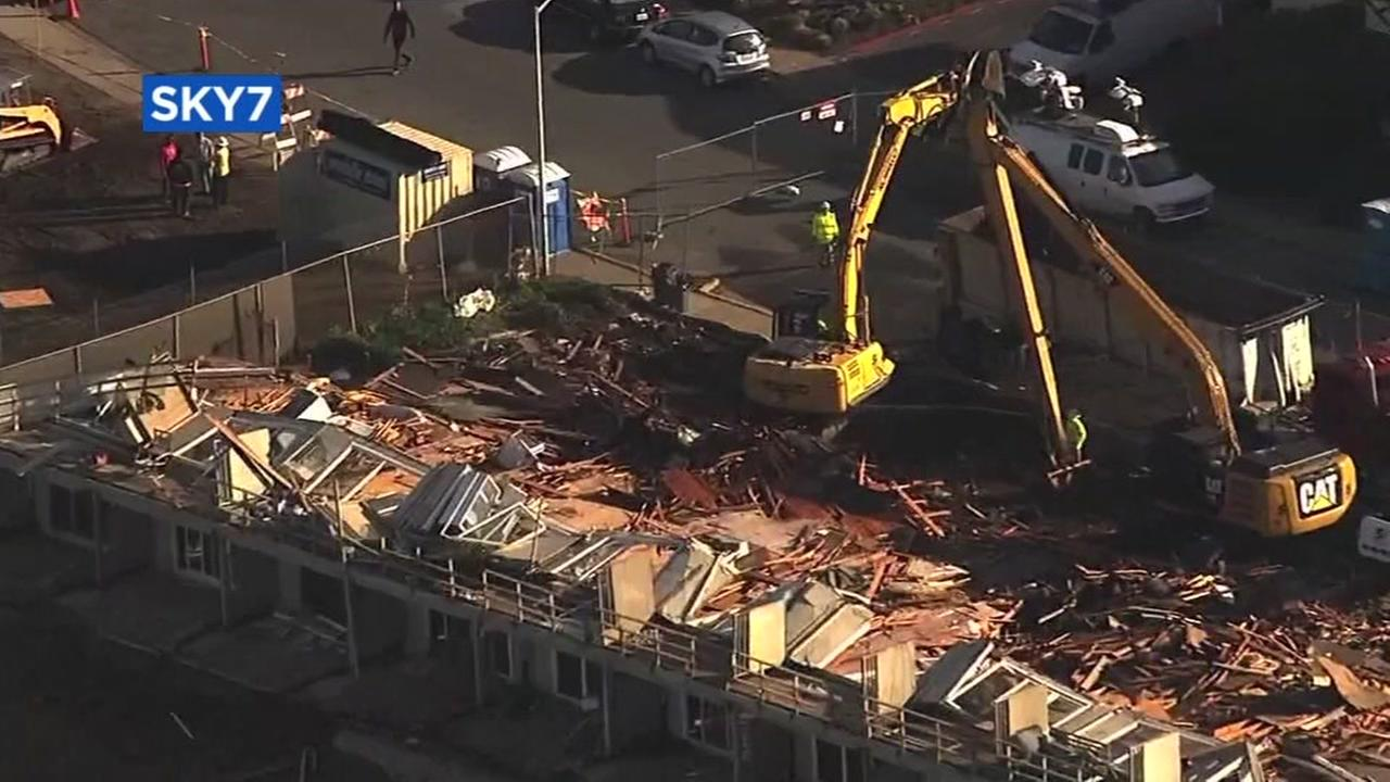 Crews are seen demolishing a condemned 20-unit apartment building in Pacifica, Calif. on Monday, January 30, 2017.