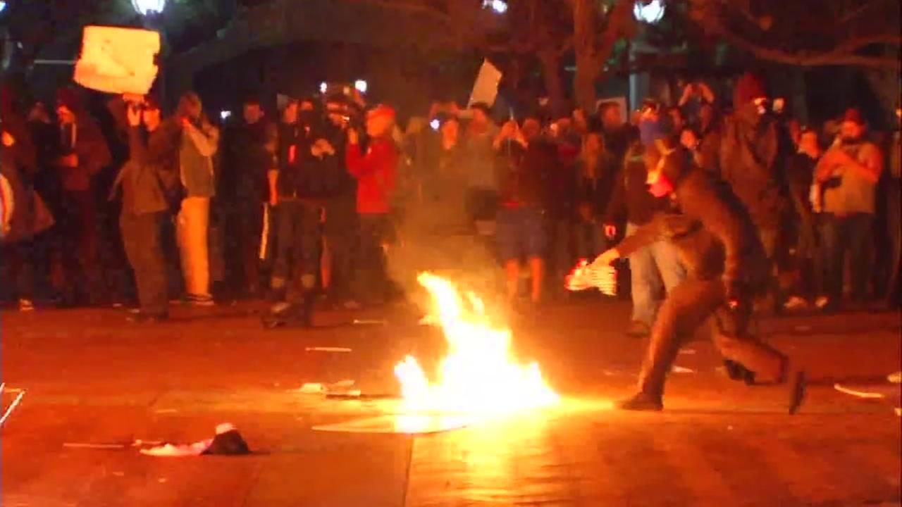 Masked protesters light a fire at U.C. Berkeley in Berkeley, Calif. on Feb. 2, 2017.