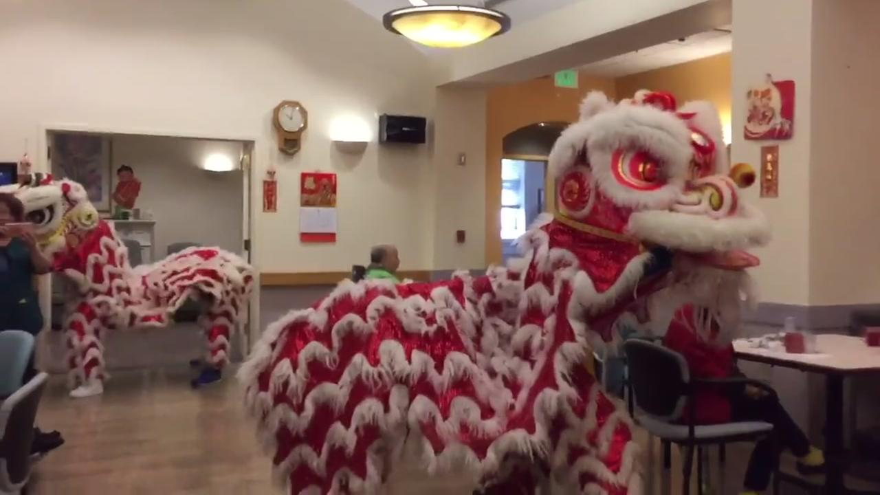 SFPD Lion Dance Team performs for seniors