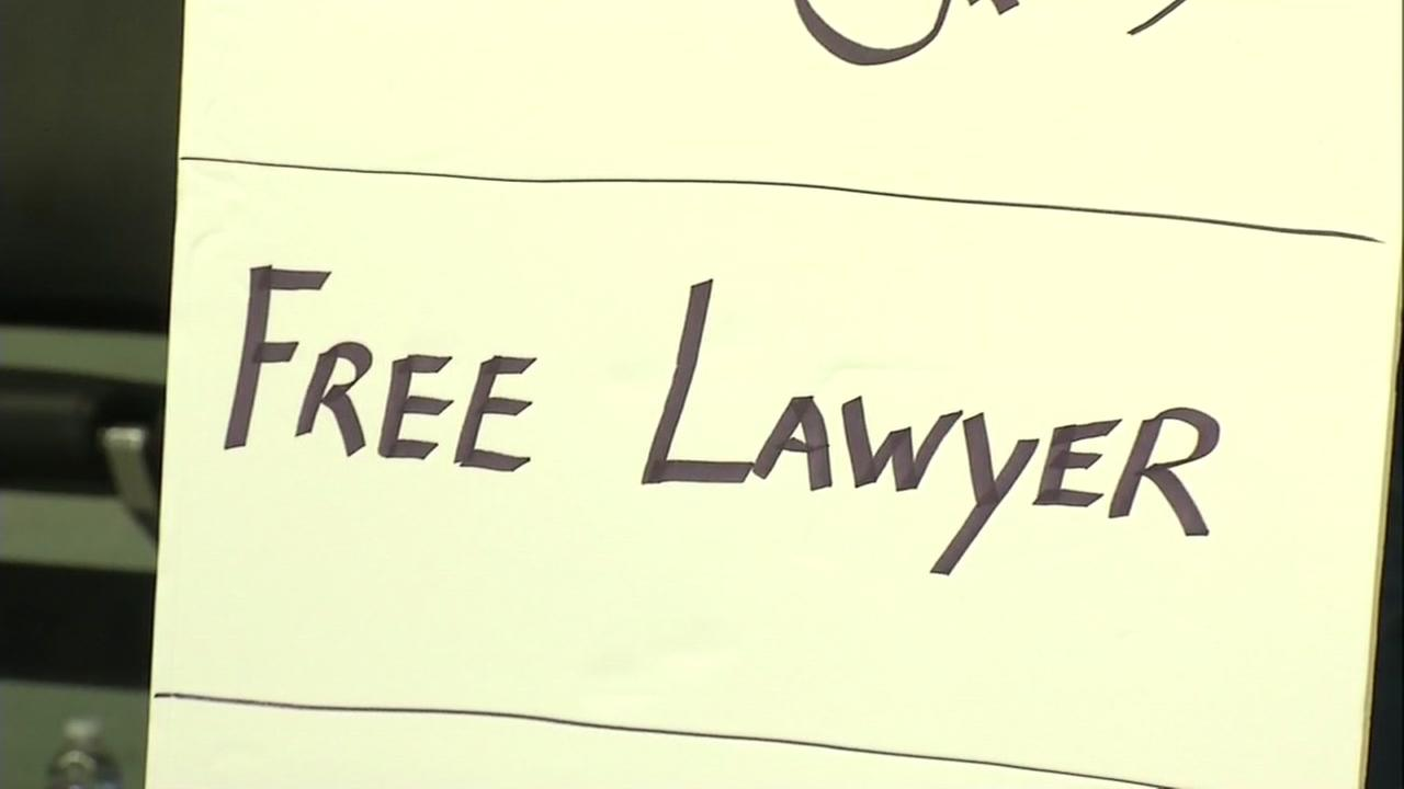 A sign offering free help from a lawyer is seen in the International terminal of San Francisco International Airport on Saturday February 4, 2017.