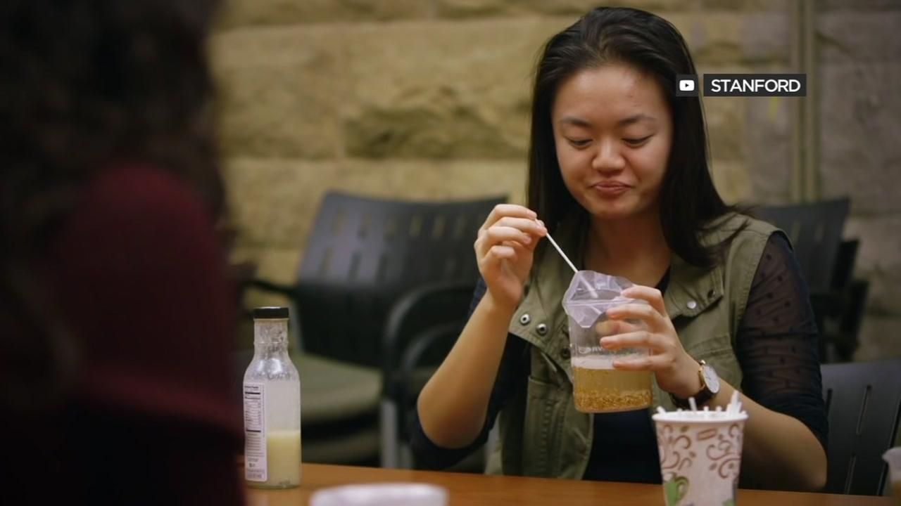 A Stanford student is seen drinking beer made using 5,000-year-old recipe recipe from China.