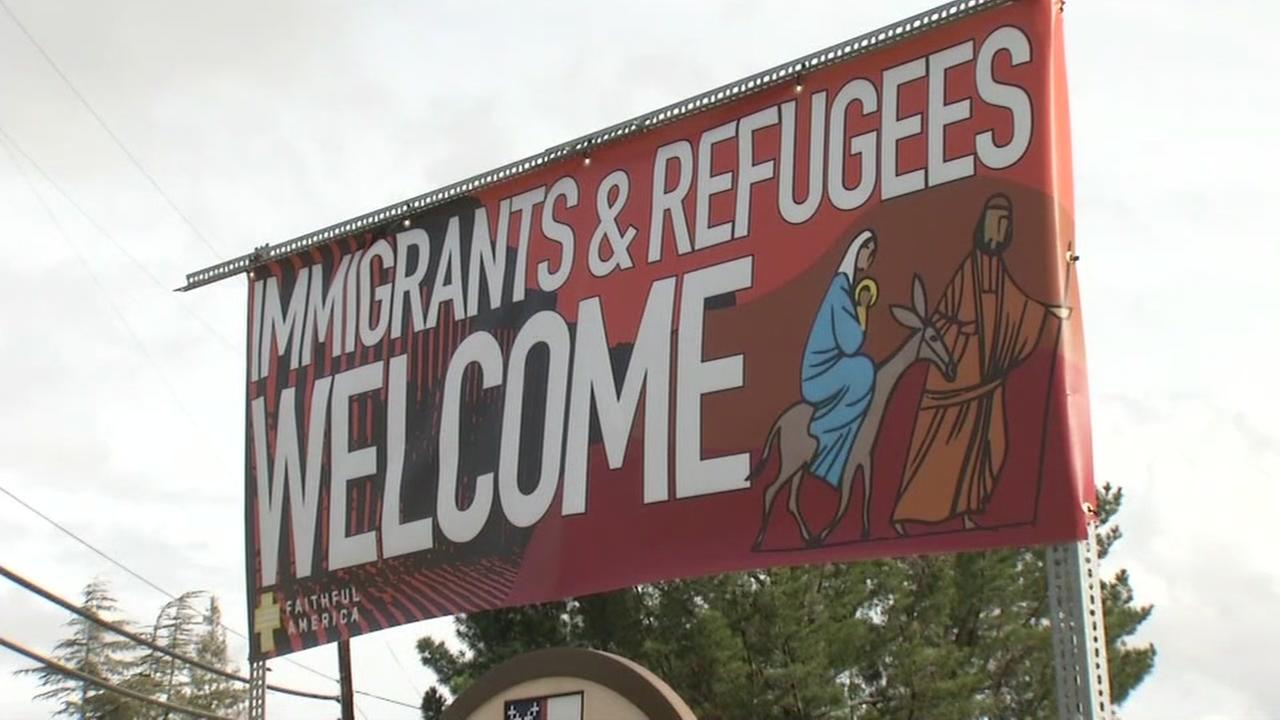 Church banner welcoming immigrants, refugees returned after being vandalized