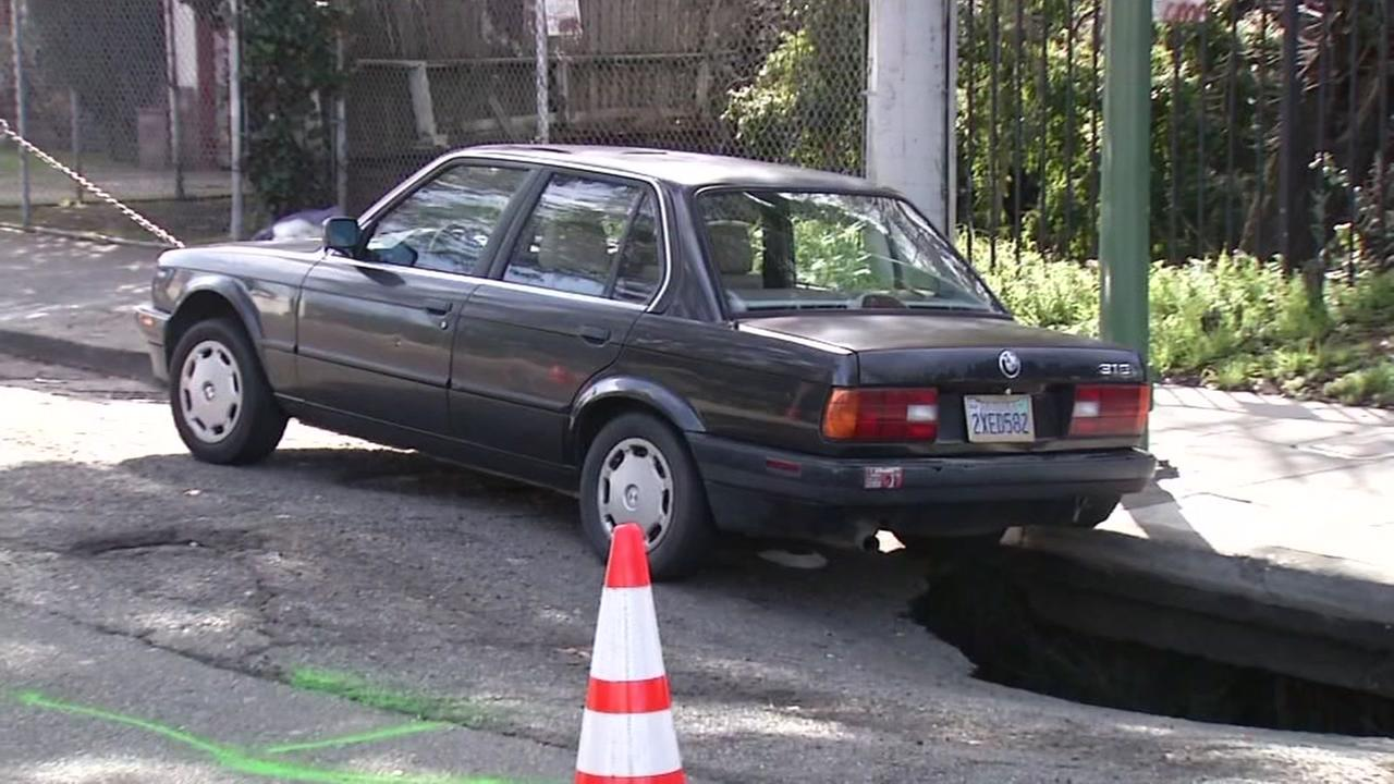 A sinkhole is seen in Oakland, Calif. on Sunday, February 12, 2017.