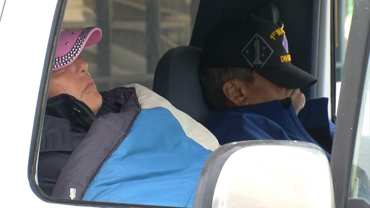 Two evacuees are seen asleep in their car in Colusa, Calif. on Feb. 13, 2017.