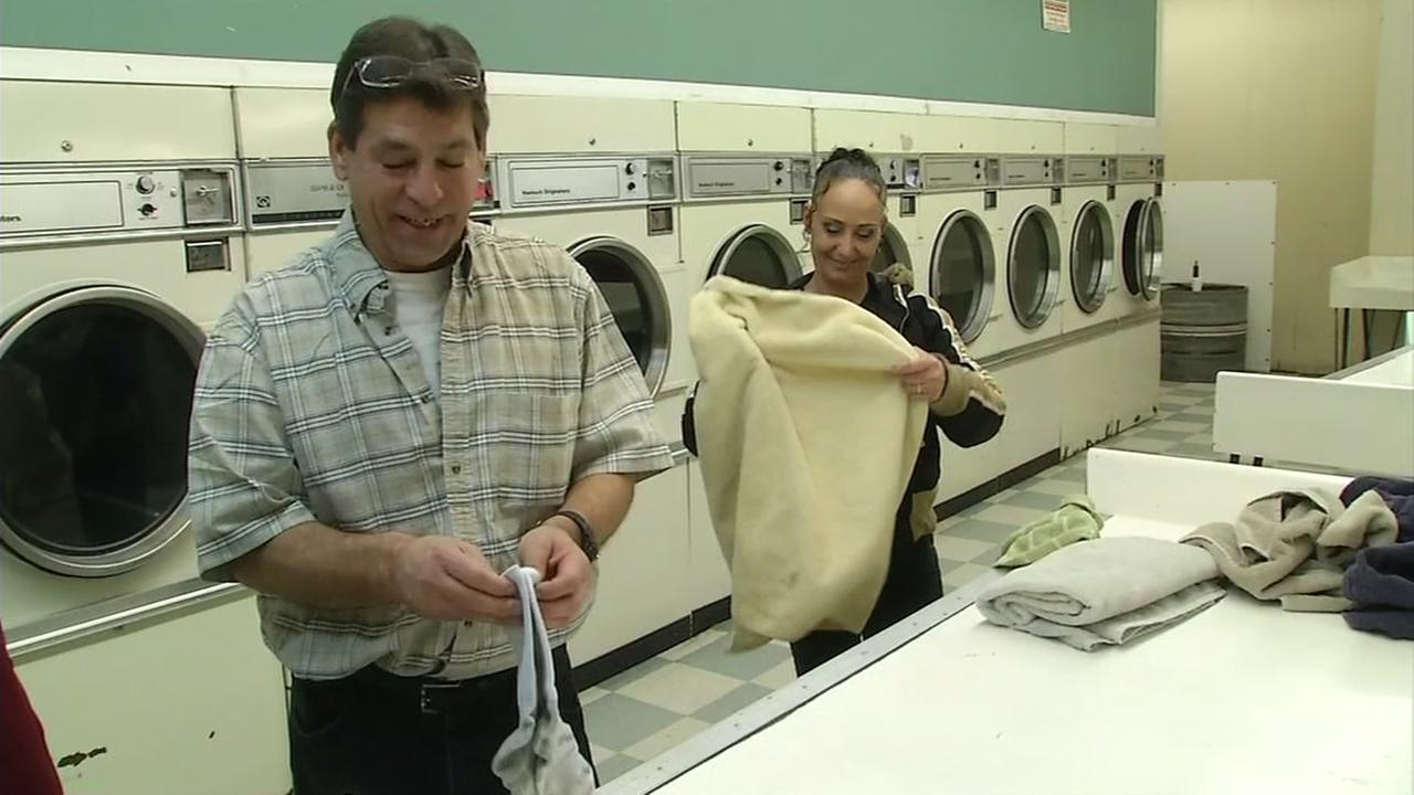 Two Oroville residents do laundry downtown after returning home from evacuations on Feb. 14, 2017.