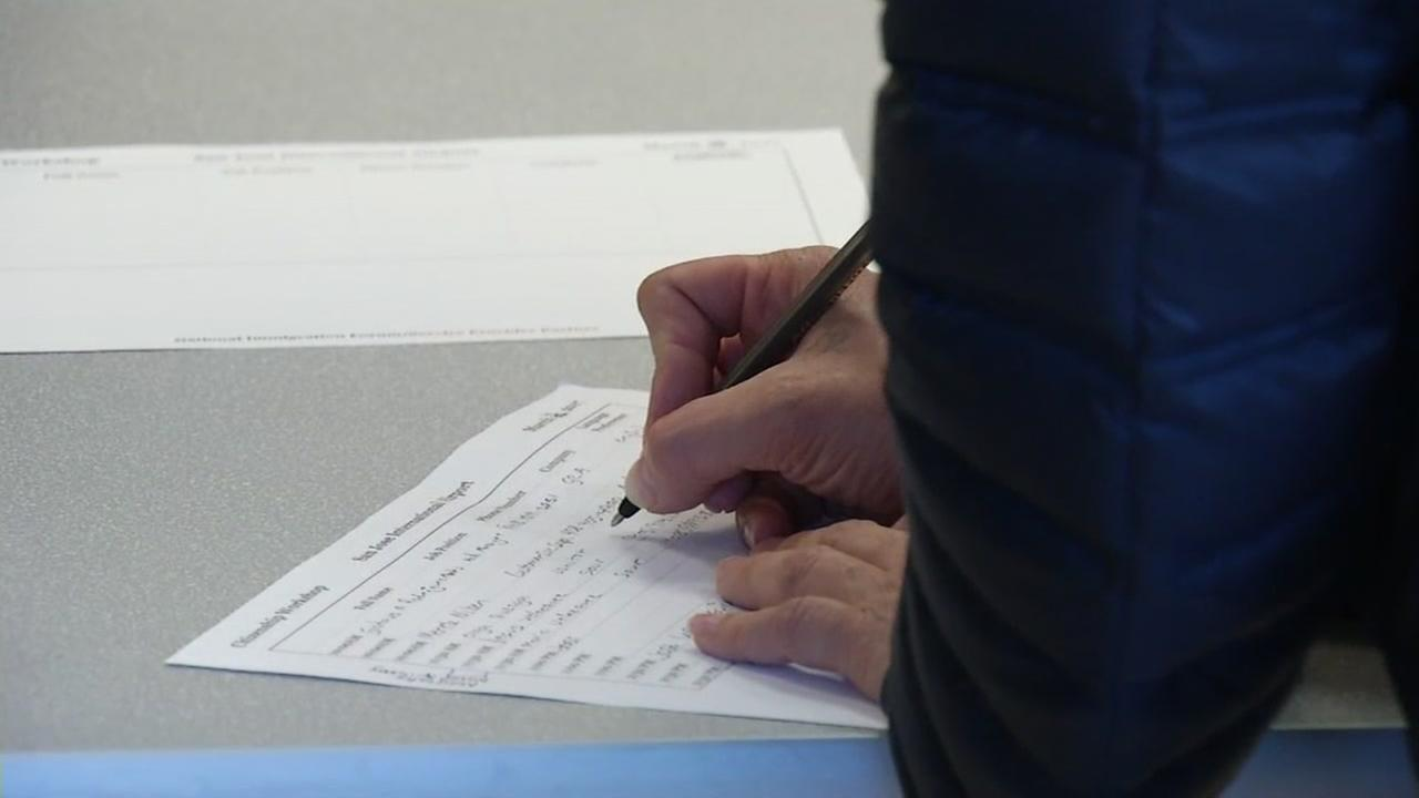 A person is seen filling out immigration paperwork in this undated image.