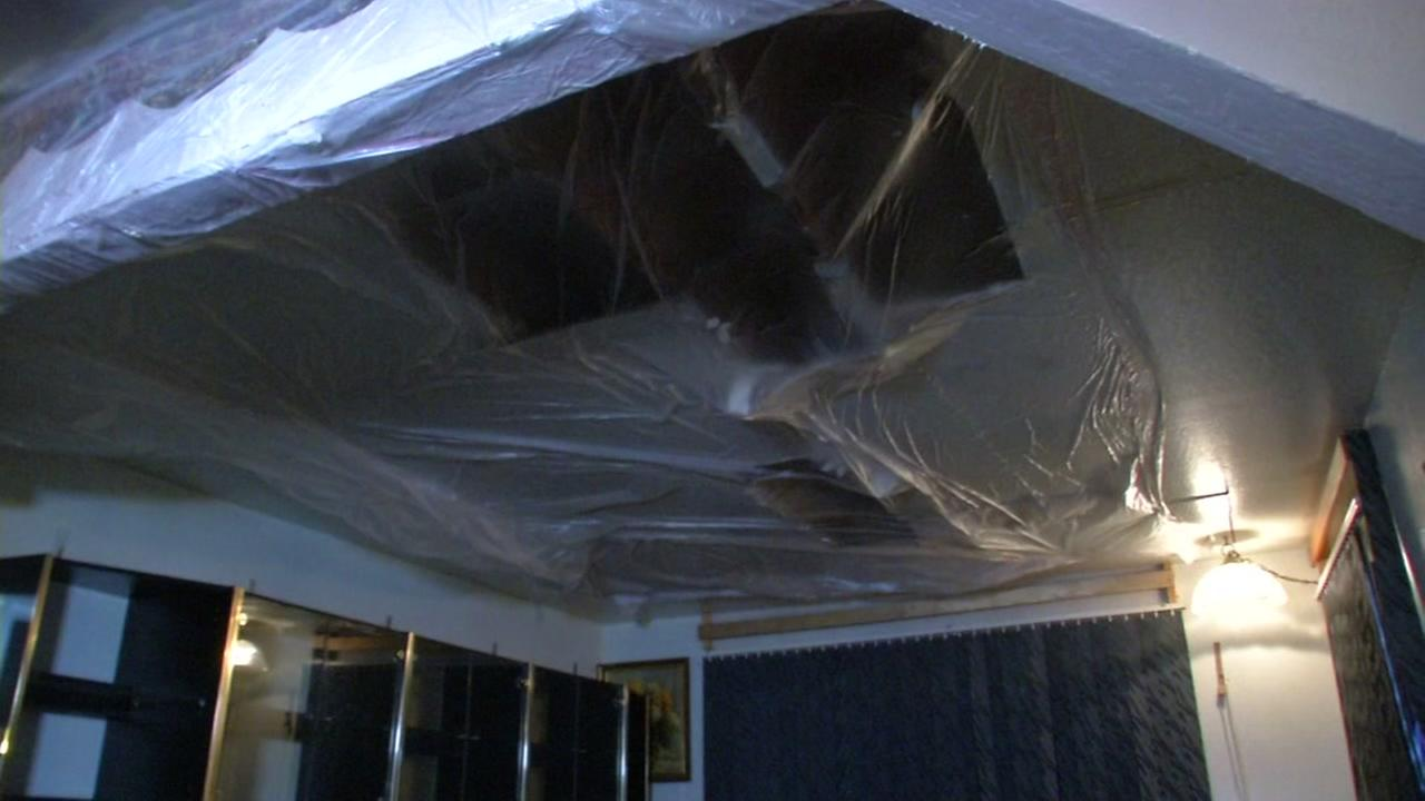 A tarp appears on the ceiling of a Solano County  couples home in California.