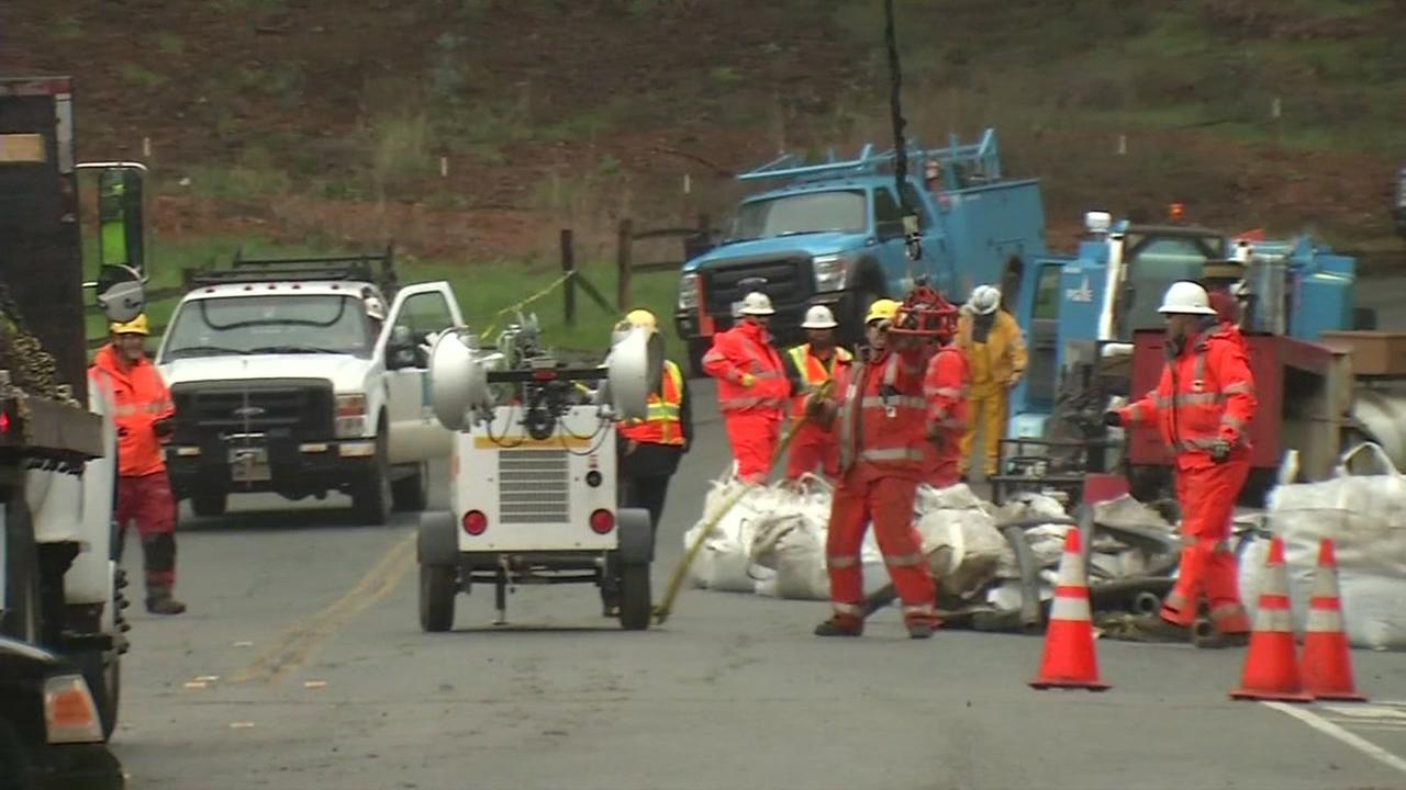 PG&E crews work to shore up a mudslide thats threatening power lines in Orinda, Calif. on Feb. 19, 2017.KGO-TV