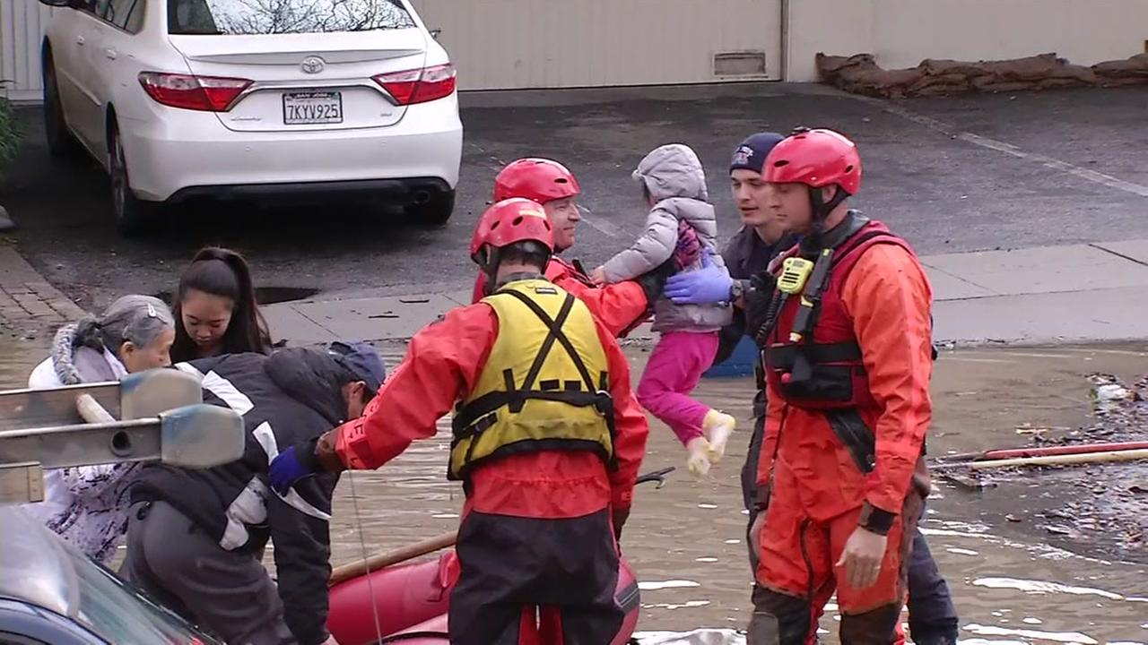 San Jose Firefighters rescue residents by boat from flooded homes on Tuesday February 17, 2017.KGO-TV