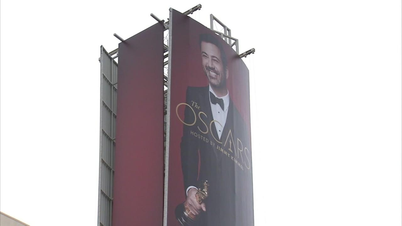 A sign advertising Jimmy Kimmel hosting the Oscars appears in Los Angeles above Dolby Theatre.