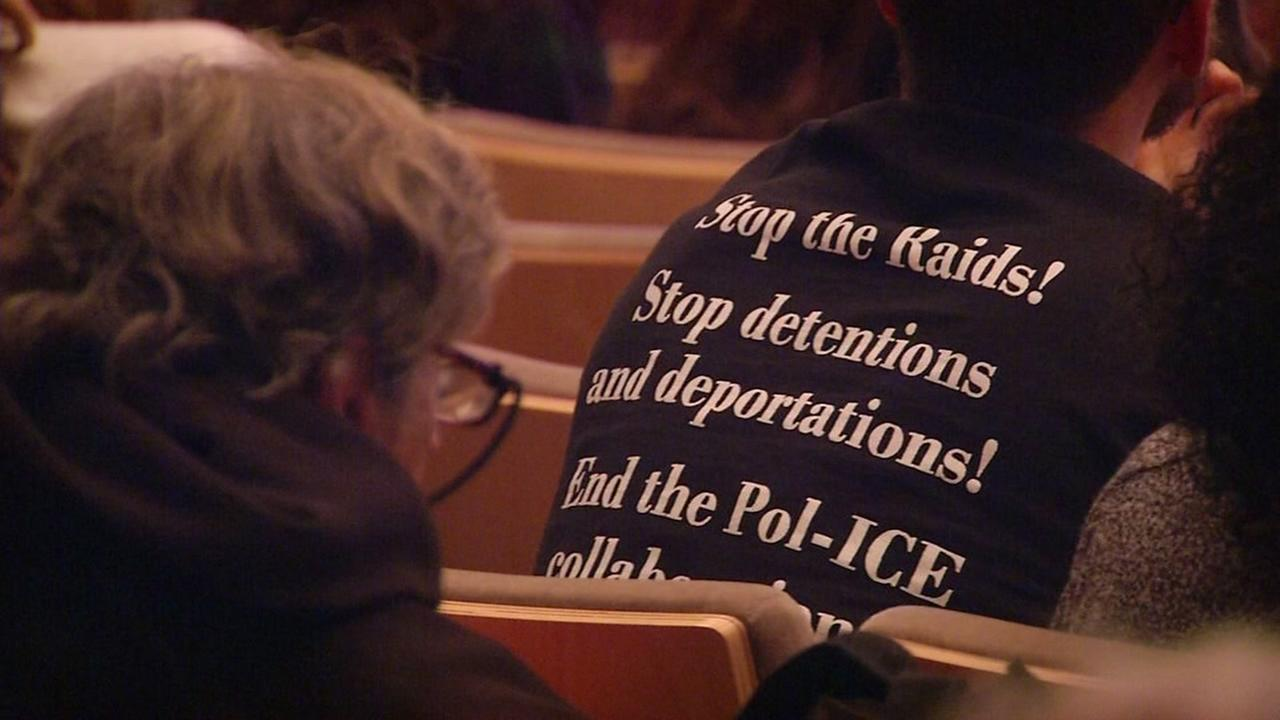 A man wears a pro-immigration shirt at a San Francisco Board of Supervisors meeting on Feb. 22, 2017.