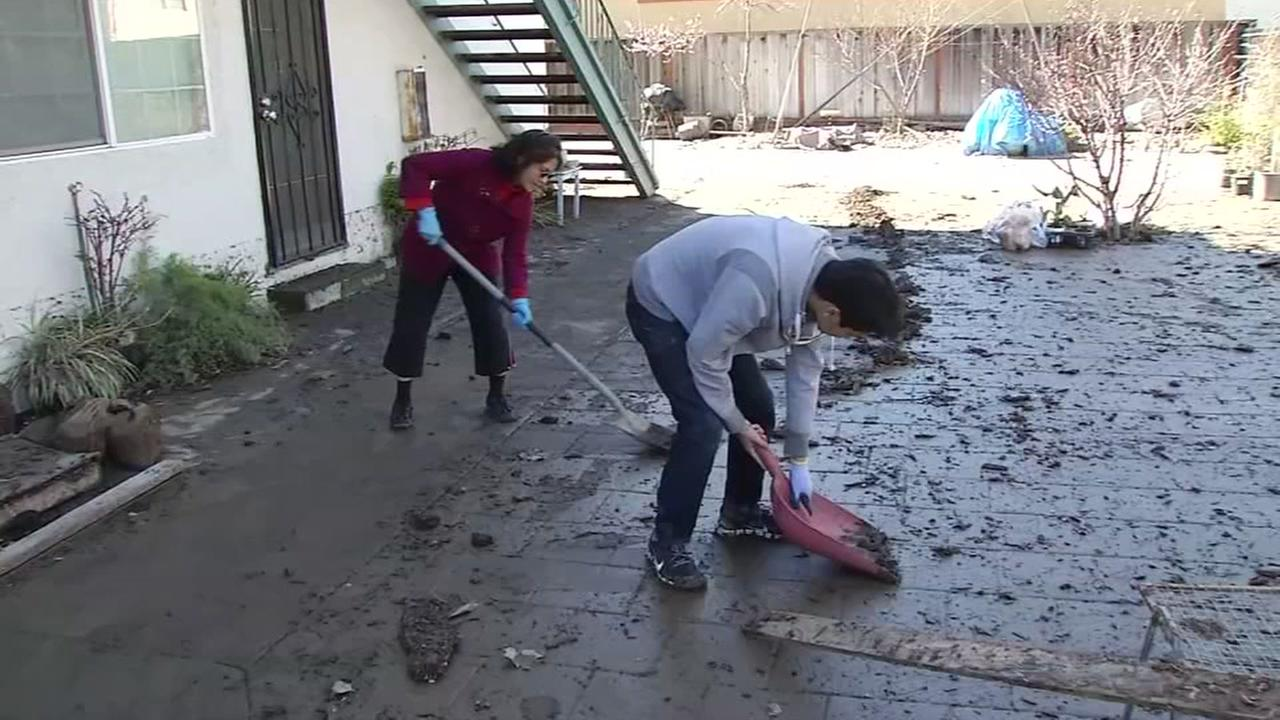 Residents are seen cleaning up flood damage in San Jose, Calif. on Thursday February 23, 2017.