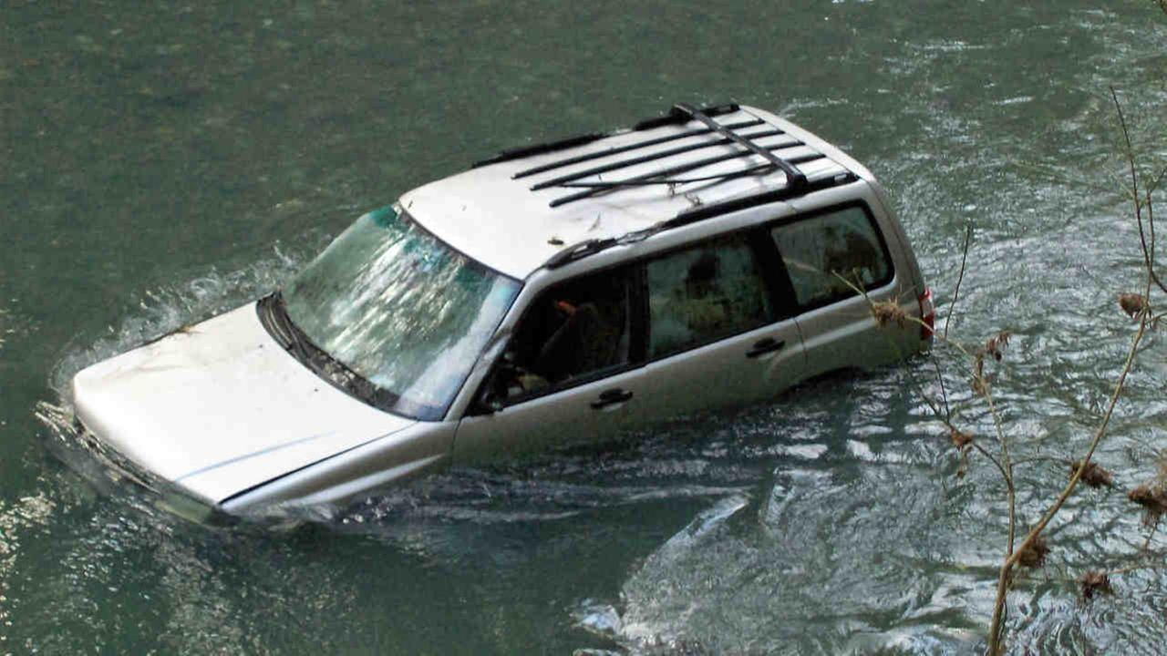 A car is seen submerged in Austin Creek near Cazadero, Calif. on Saturday February 25, 2017.