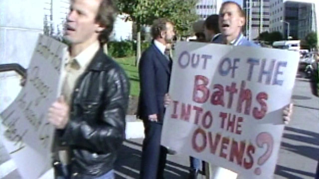 Protesters hold up signs in this undated image from the 1970s.