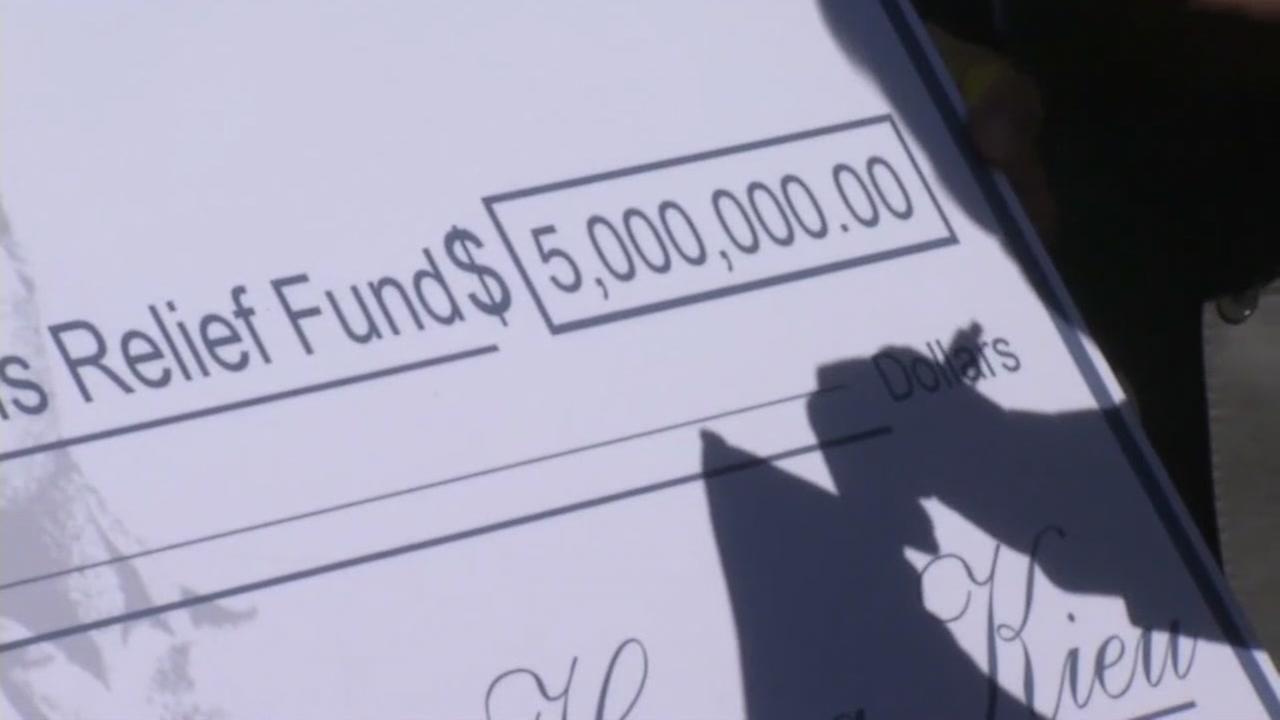 Billionaire philanthropist Kieu Hoang presents a $5 million check to San Jose flood relief efforts on Mar. 1, 2017.