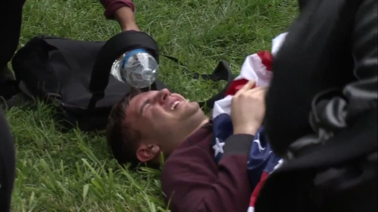 An injured protester is seen on the ground in Berkeley California on Saturday March 4, 2017.KGO-TV
