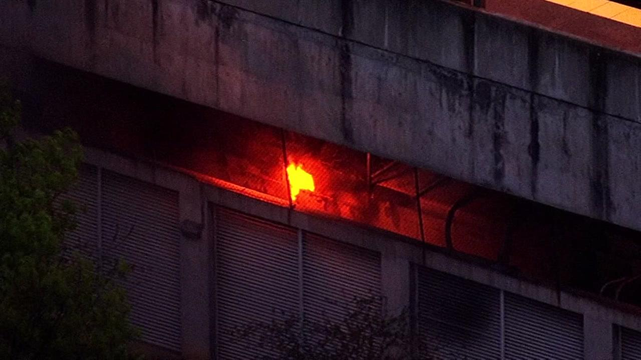Fire is seen under BART tracks at the station in Walnut Creek, Calif. on Saturday, March 4, 2017.