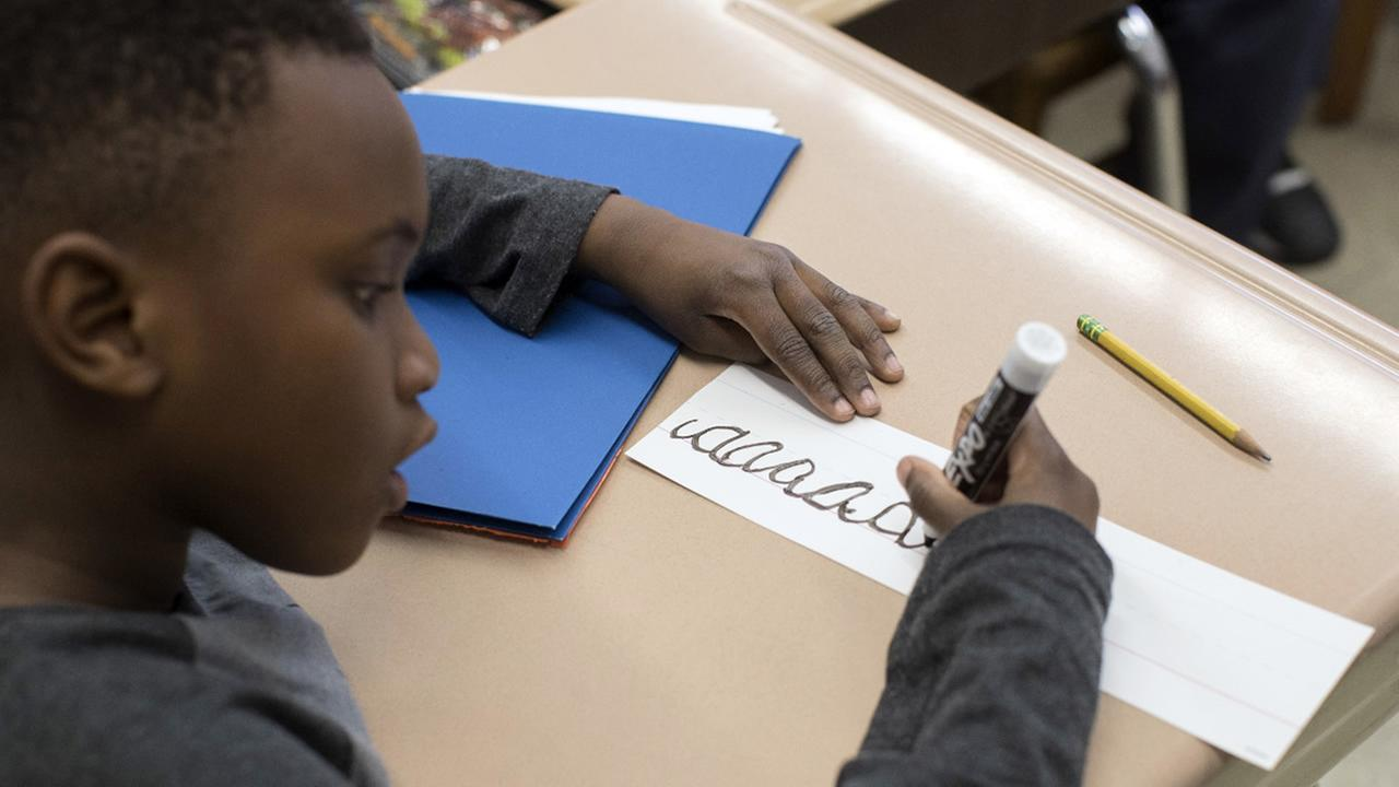In this Wednesday, March 1, 2017, photo, a third-grader practices his cursive handwriting at P.S.166 in the Queens borough of New York. (AP Photo/Mary Altaffer)