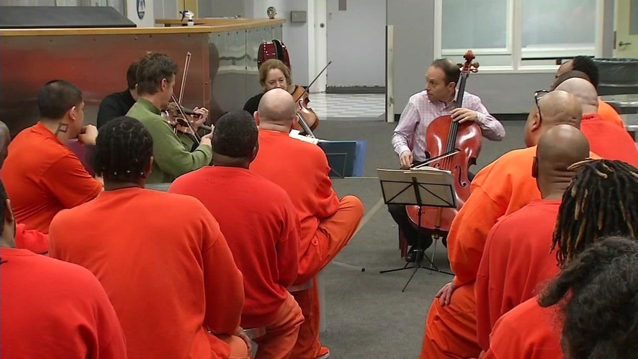 Inmates at the San Francisco County Jail Number Five listen to the Saint Lawrence String Quartet in San Bruno, Calif. on March, 7, 2017.