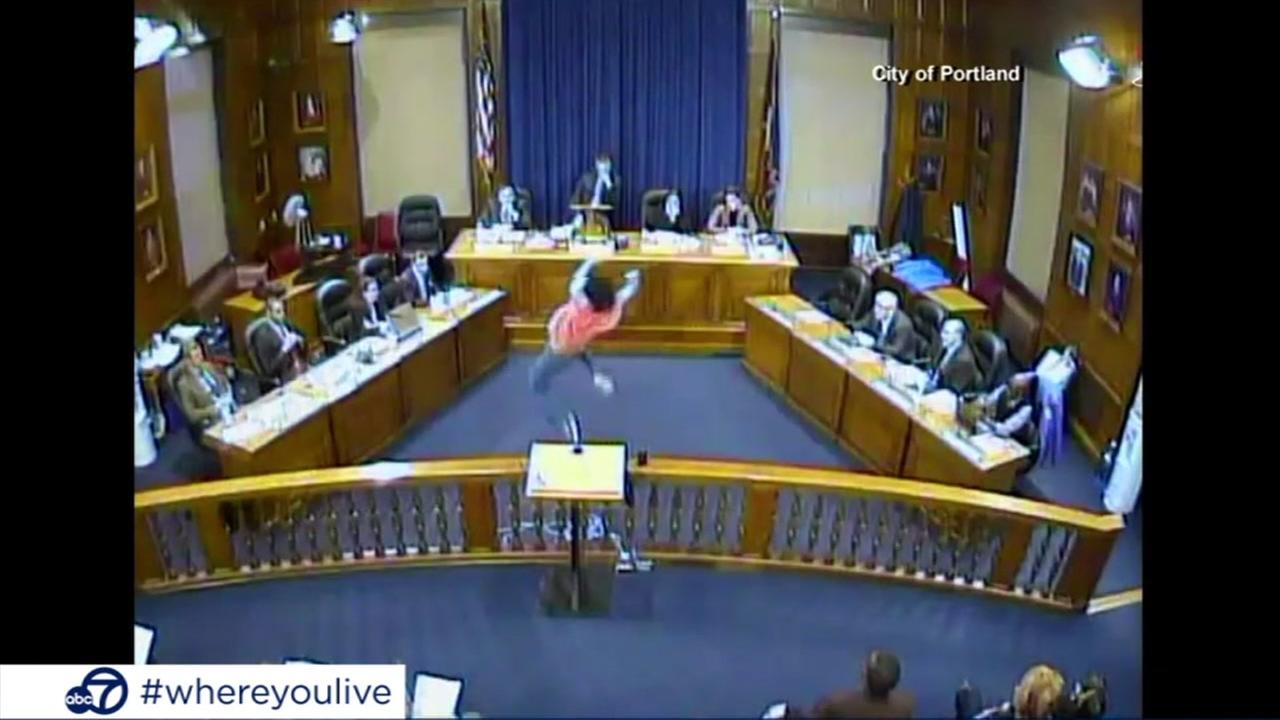 KNOW AND TELL: Woman performs interpretive dance at city hall meeting