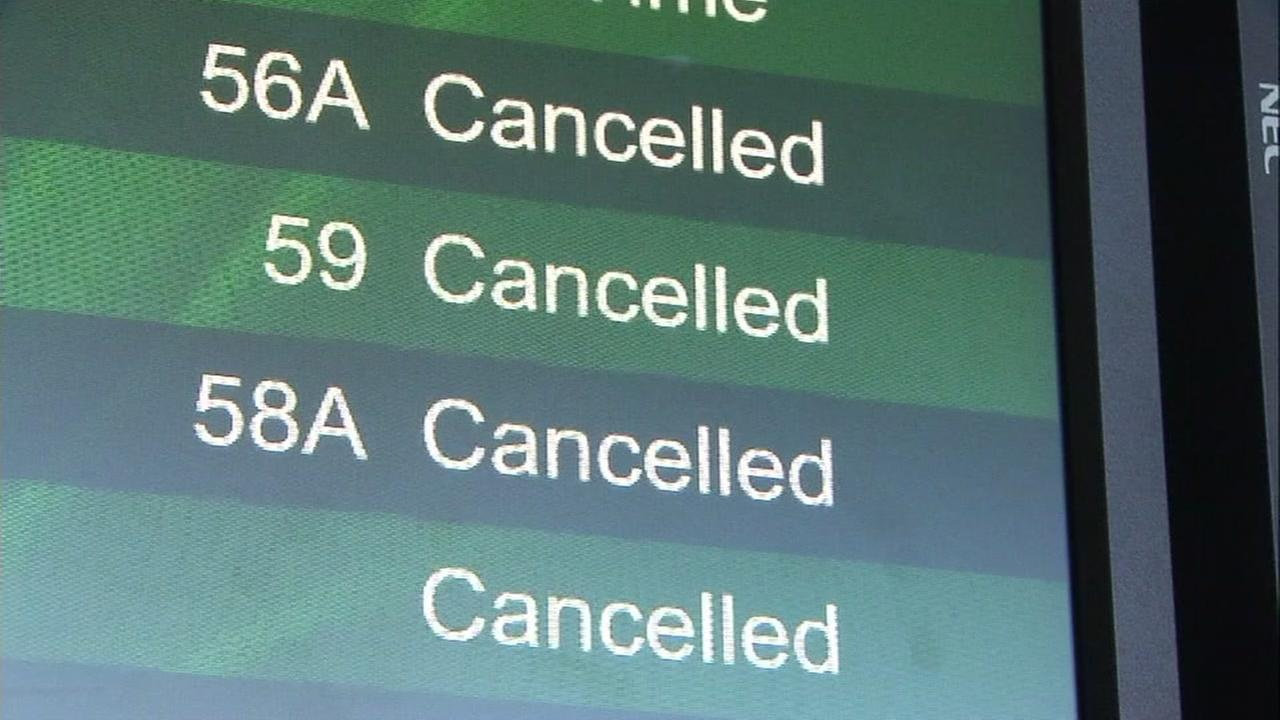A board showing canceled flights is seen in this undated image.