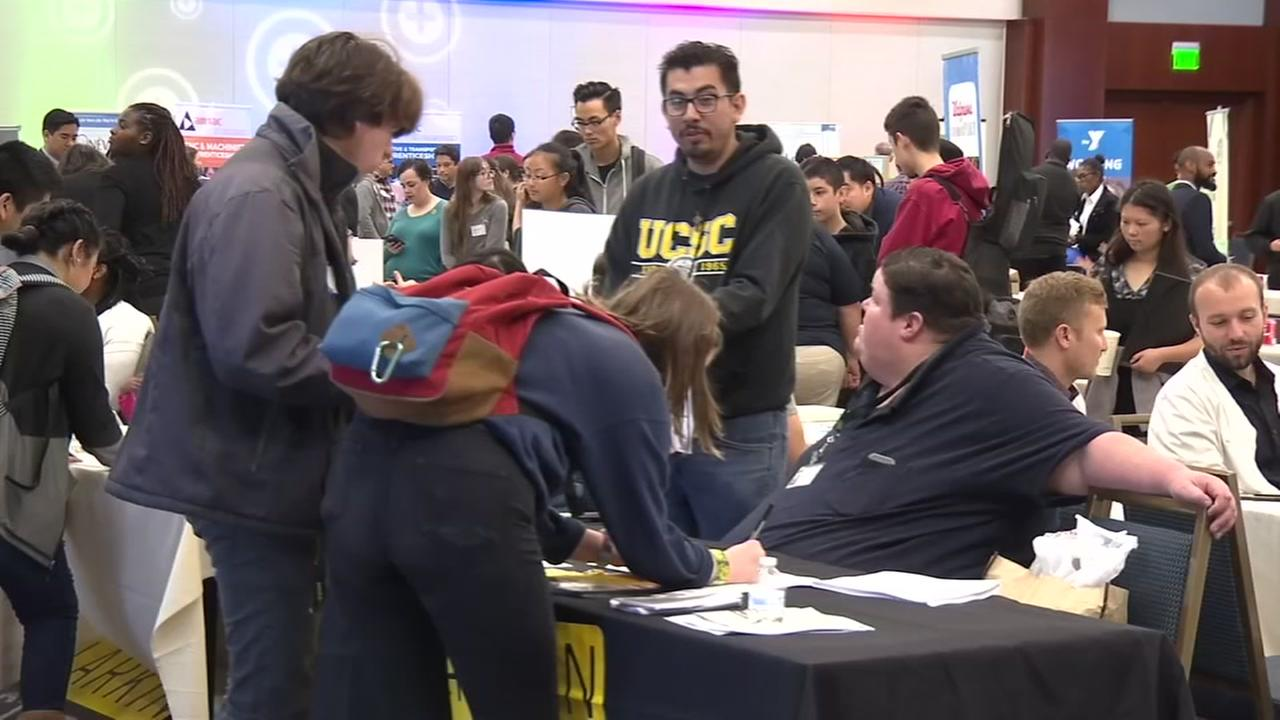 A job fair is seen in San Francisco on Saturday March 18, 2017.