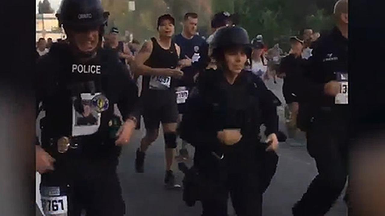 Fresno police officers are seen running in the Skechers Performance Los Angeles Marathon in full uniform on Sunday, March 19, 2017.
