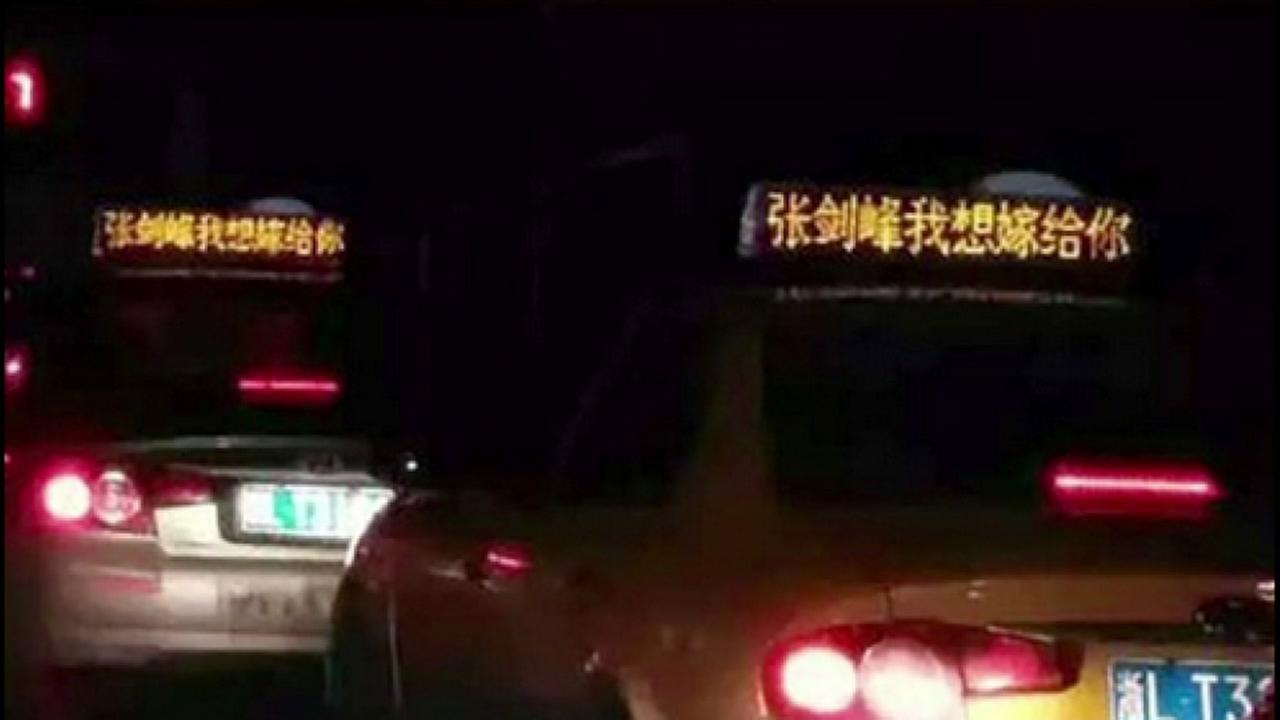 A marriage proposal appears on taxi cabs in China.