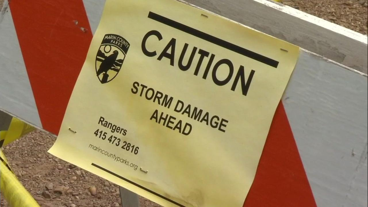 A sign warning about storm damage is seen in Marin County on Sunday, March 26, 2017.