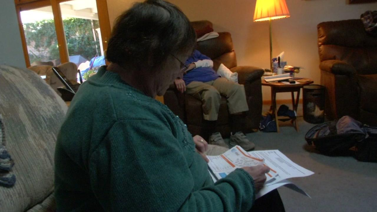 AT&T customer Sharon Silliven-Reiley looks through her bills at her home in Antioch, Calif. on Monday, April 3, 2017.