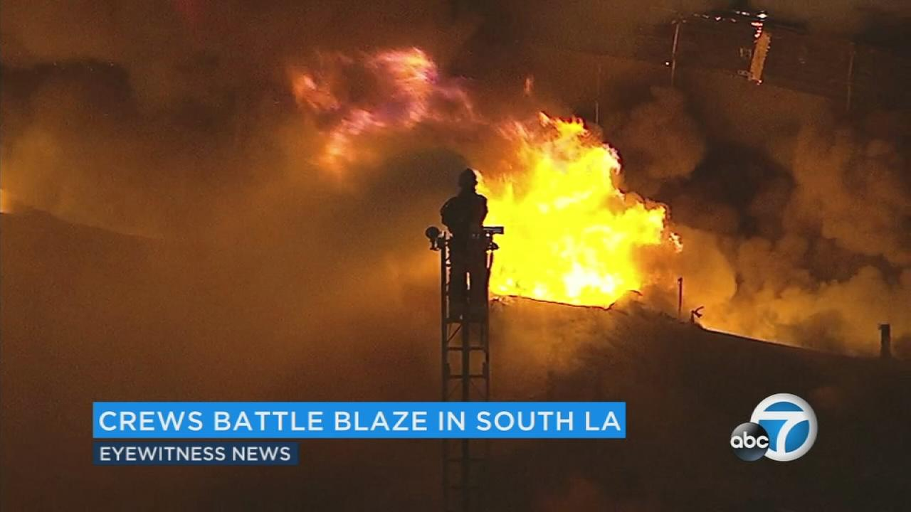 Firefighters battled a massive blaze in South Los Angeles on Monday, April 3, 2017.