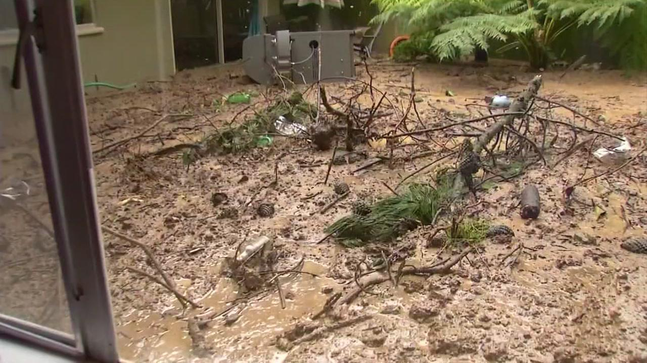 The aftermath of a mudslide is seen in the backyard of an Oakland Hills home in Oakland, California on Friday April 7, 2017.