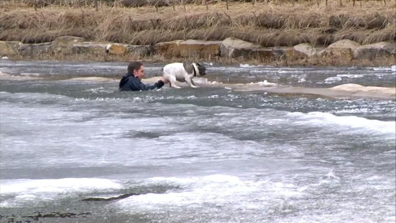 A man is seen in an icy pond after jumping in to rescue his dog in Canada in this undated image.