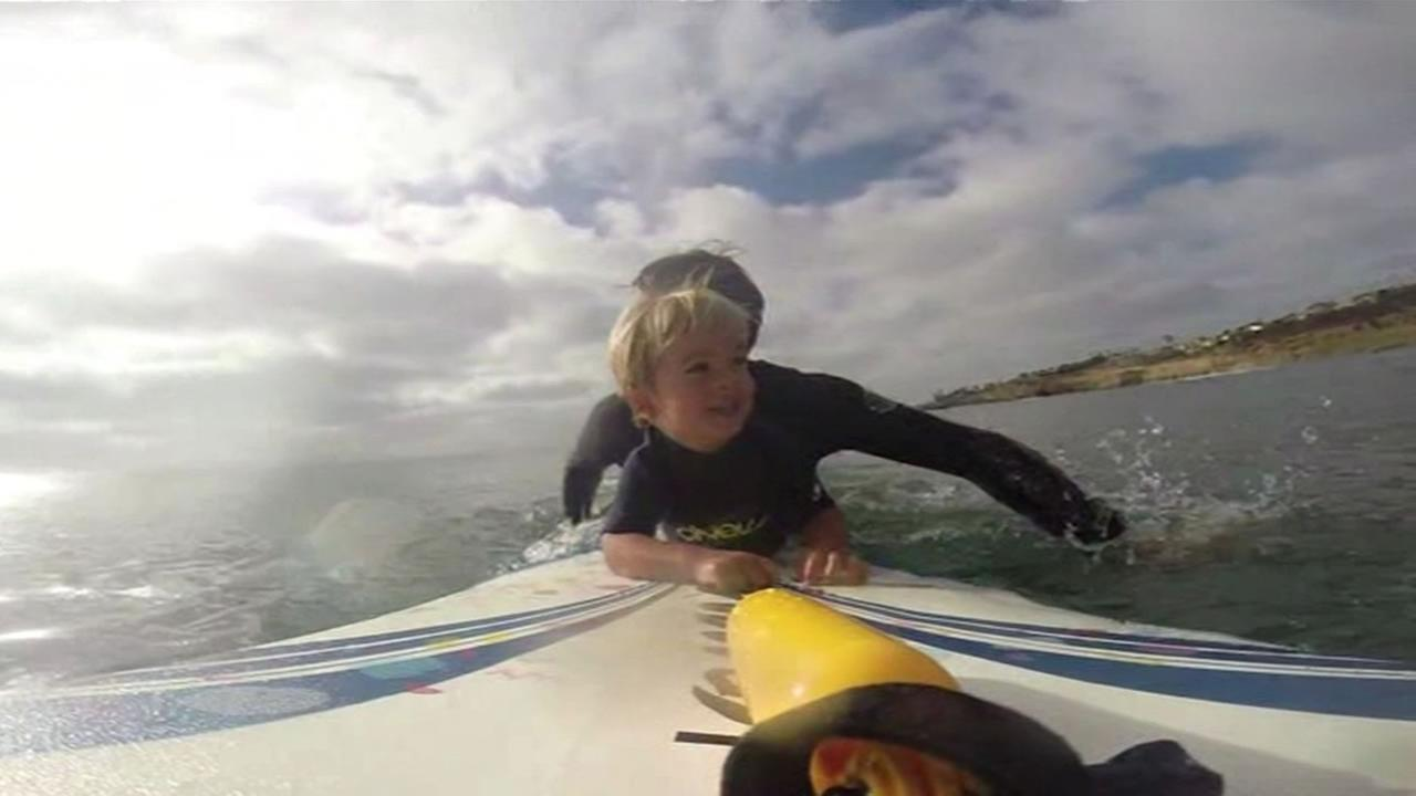 There are few feelings more enjoyable than taking off on a wave and standing up on the board, and one two-year-old is getting an early start.