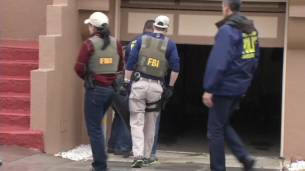 FBI investigators raid the home of San Francisco Sheriffs Deputy April Myres on Feb. 3, 2017.