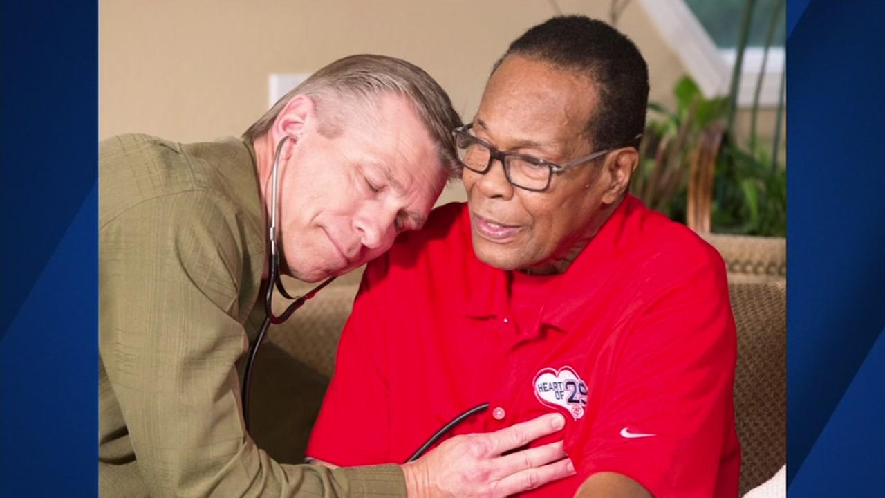 Konrad Reuland is seen listening to his sons heart beat inside of Baseball Hall-of-Famer Rod Carew after an organ transplant in this undated image.
