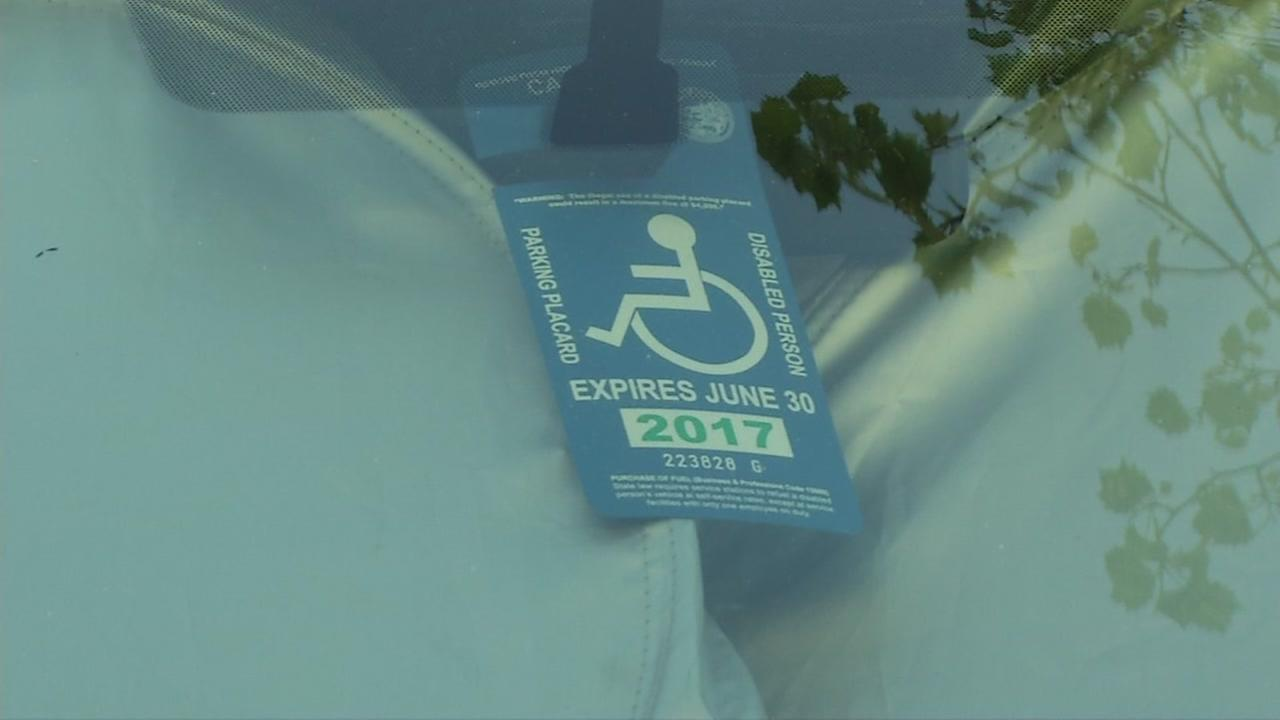 A handicap parking placard is seen in this undated image.