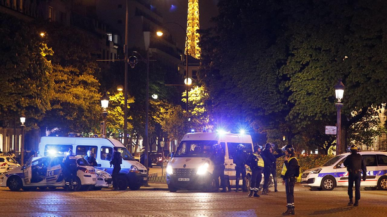 Police take positions near the Champs Elysees avenue in Paris, France, after a fatal shooting in which a police officer was killed along with an attacker, Thursday, April 20, 2017.