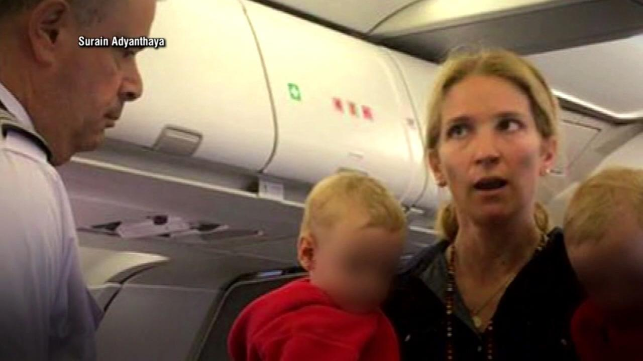 An American Airlines passenger is seen during an altercation with flight attendants.