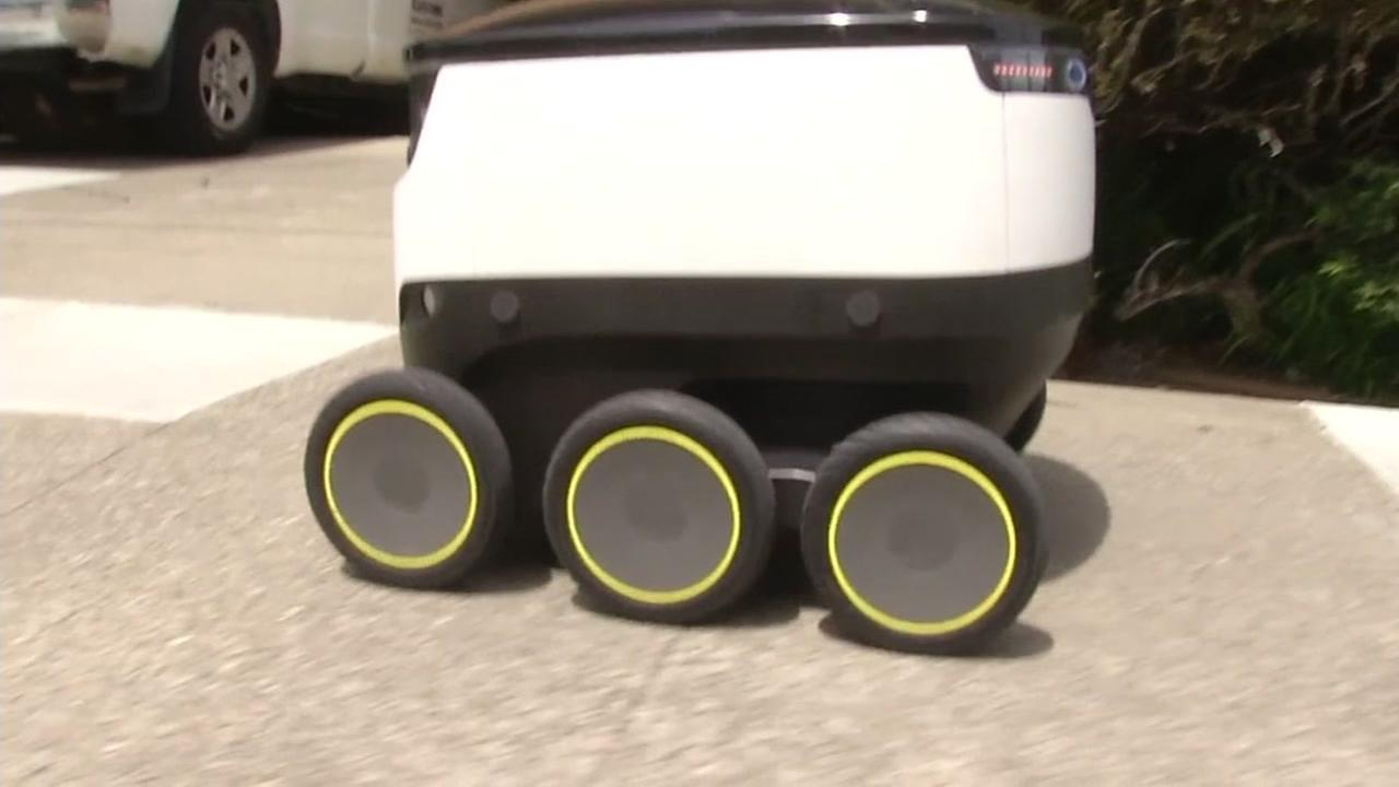 A Starship Technologies robot is seen making deliveries in San Carlos, Calif., on Tuesday, April 25, 2017.
