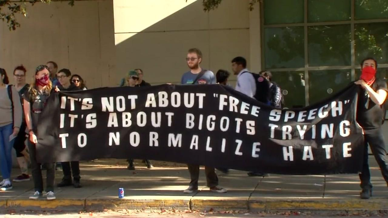 Protesters hold a banner at UC Berkeley on Thursday, April 27, 2017.