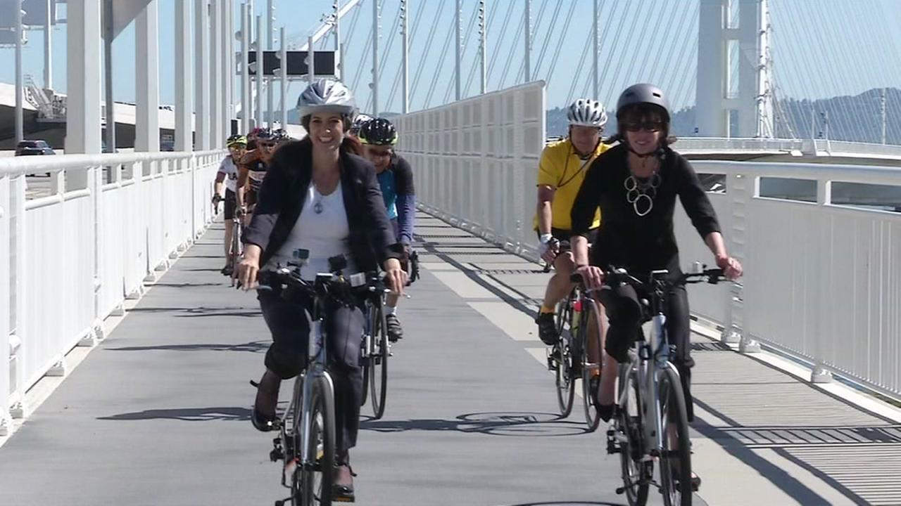 Bicyclists are seen riding over the Bay Bridge bike, pedestrian path on Tuesday, May 2, 2017.