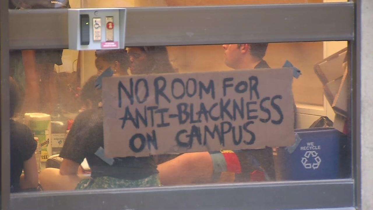 A sign appears in the window of Kerr Hall during a protest on Tuesday, May 5, 2017.