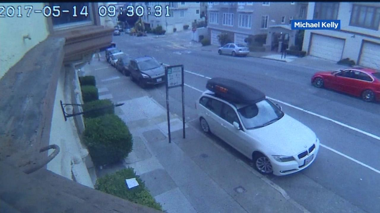 Surveillance video shows the driver of a red BMW firing a gun at another vehicle in San Francisco on Sunday, May 14, 2017.